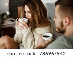 couple with coffee at bedroom  | Shutterstock . vector #786967942