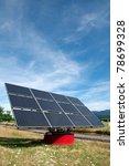 Solar panel against blue sky near the highway - stock photo