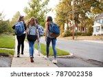 Four young teen girls walking...