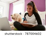 young teen girl studying on her ... | Shutterstock . vector #787004602