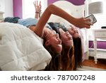 Three Teenage Girls Lying On...