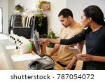 man and woman working behind... | Shutterstock . vector #787054072