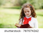 smart little girl reading a... | Shutterstock . vector #787074262