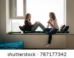 daughter and mother having tea... | Shutterstock . vector #787177342