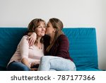 loving mother being kissed by... | Shutterstock . vector #787177366