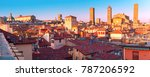 Aerial panoramic view of Bologna Cathedral and towers towering above of the roofs of Old Town in medieval city Bologna in the sunny day, Emilia-Romagna, Italy