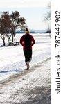 man jogging during winter   Shutterstock . vector #787442902