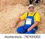 bearded farmer in blue overalls ... | Shutterstock . vector #787454302
