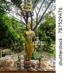 Small photo of Buddha statue at the gardens of Buddhist temple Wat Kao Iti Sukato in Hua Hin, Thailand