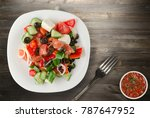 greek salad on a wooden... | Shutterstock . vector #787647952