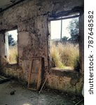 Small photo of two window at an abounded house