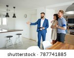 young couple with a real estate ... | Shutterstock . vector #787741885