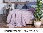 powder color knitted blanket on ... | Shutterstock . vector #787793572