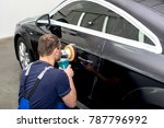 a man polishes a black car with ...   Shutterstock . vector #787796992