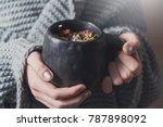 herb tea in black ceramic cup ... | Shutterstock . vector #787898092