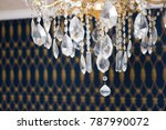Small photo of Ornamental chandelier hanging in elegant sitting room