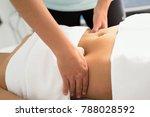 hands massaging female abdomen... | Shutterstock . vector #788028592