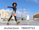 young fit black woman on roller ... | Shutterstock . vector #788029762