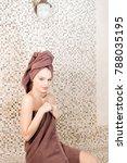 young woman relaxing in a sauna ... | Shutterstock . vector #788035195