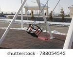 Small photo of empty swing in playground