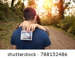 happy couple pregnant while... | Shutterstock . vector #788152486