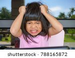 Small photo of Angry Asian cute girl screaming after her mother take a tablet away. Stressed child, Kid with attention deficit hyperactivity disorder (ADHD) can't handle her emotion.