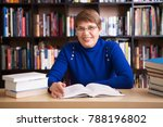 happy senior woman  with books... | Shutterstock . vector #788196802