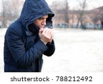 man breathing on his hands to... | Shutterstock . vector #788212492