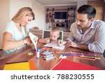 mom and dad drawing with their... | Shutterstock . vector #788230555