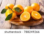 fresh orange fruits with leaves ... | Shutterstock . vector #788249266