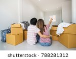 young asian couple moving into... | Shutterstock . vector #788281312
