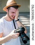 Small photo of photography fails. professional photographer laughs at some bad shot. stupid accidental mistakes. working process concept