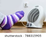 a woman warms her feet in front ...   Shutterstock . vector #788315905
