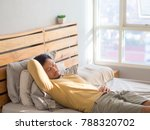 asian man sleeping on his bed... | Shutterstock . vector #788320702