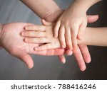 mother holding baby hand | Shutterstock . vector #788416246