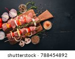 raw kebab from meat on a wooden ... | Shutterstock . vector #788454892