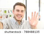 man waving on a video call... | Shutterstock . vector #788488135