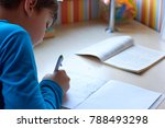 the schoolboy at the desk... | Shutterstock . vector #788493298