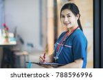 portrait of a beautiful nurse... | Shutterstock . vector #788596996