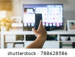 hand with led tv remote control | Shutterstock . vector #788628586