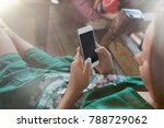 Young Woman Holding Smartphone...