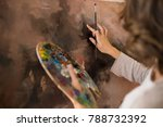 artist paints a picture of oil... | Shutterstock . vector #788732392