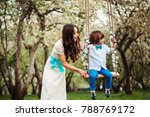 happy dressy mother and toddler ... | Shutterstock . vector #788769172