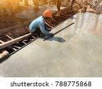 man hand spreading concrete mix ... | Shutterstock . vector #788775868