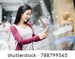young woman taking a photo of a ... | Shutterstock . vector #788799565