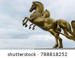 Bronze statue of two horses in...