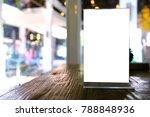 mock up menu frame standing on... | Shutterstock . vector #788848936
