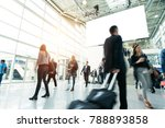 blurred people in a modern hall | Shutterstock . vector #788893858