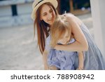 a beautiful young mother plays... | Shutterstock . vector #788908942