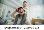 happy father carrying his... | Shutterstock . vector #788916115